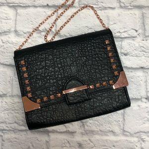 Linea Pelle black clutch bag. Rose gold chain.*
